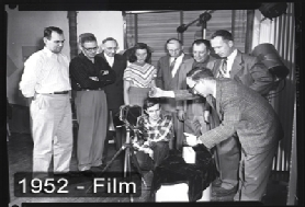 Students learning to shoot film footage in a 1952 class.