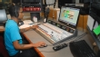 WSIU FM studio with student working the board